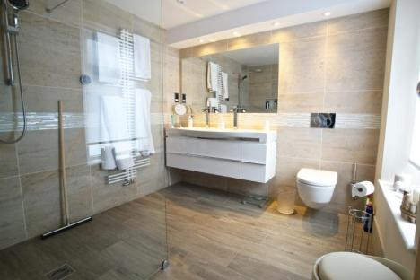 luxurious large en-suite wetroom with Laufen vanity unit