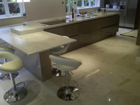 Corian worktops feature on large island with Quooker Hot Tap