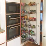 Fully stocked tall kitchen larder unit and oven housing with raised double oven and microwave