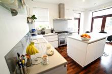 Fitted kitchen with Quooker hot tap in Corian worktops with AEG-appliances