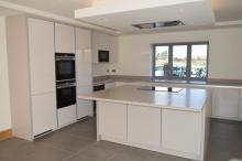 handleless gloss Keller Kitchen with Corian worktops and Seimens appliances